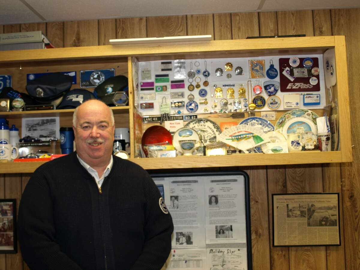 Allan Youngstein poses with his collection of Thruway memorabilia at Exit 26 in Rotterdam.