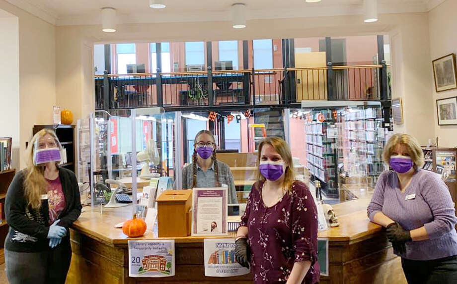The Manistee County Library participated in national Domestic Violence Awareness Month alongside other organizations in the county. The library staff wore purple masks last week and also offered victim services program stickers with the program's contact information, hand sanitizer sprays that also had the program's logo on them and pamphlets on the services offered by the program. (Courtesy photo) Photo: Courtesy