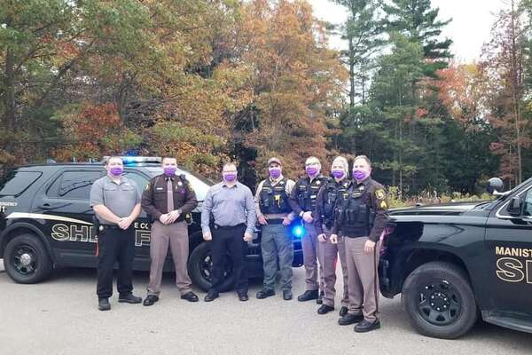 The Manistee County Sheriff's Office participated in Purple Thursday by wearing purple masks as one step to increase awareness efforts surrounding domestic violence. (From left) Lt. Jason Torrey, Manistee County Undersheriff Brian Gutowski, Det. Sgt. Scott Soper, Deputy Aaron Rybicki, Deputy Alex Schajter, Deputy Kyli Cressell-Rogers and Sgt. Paul Woroniak.