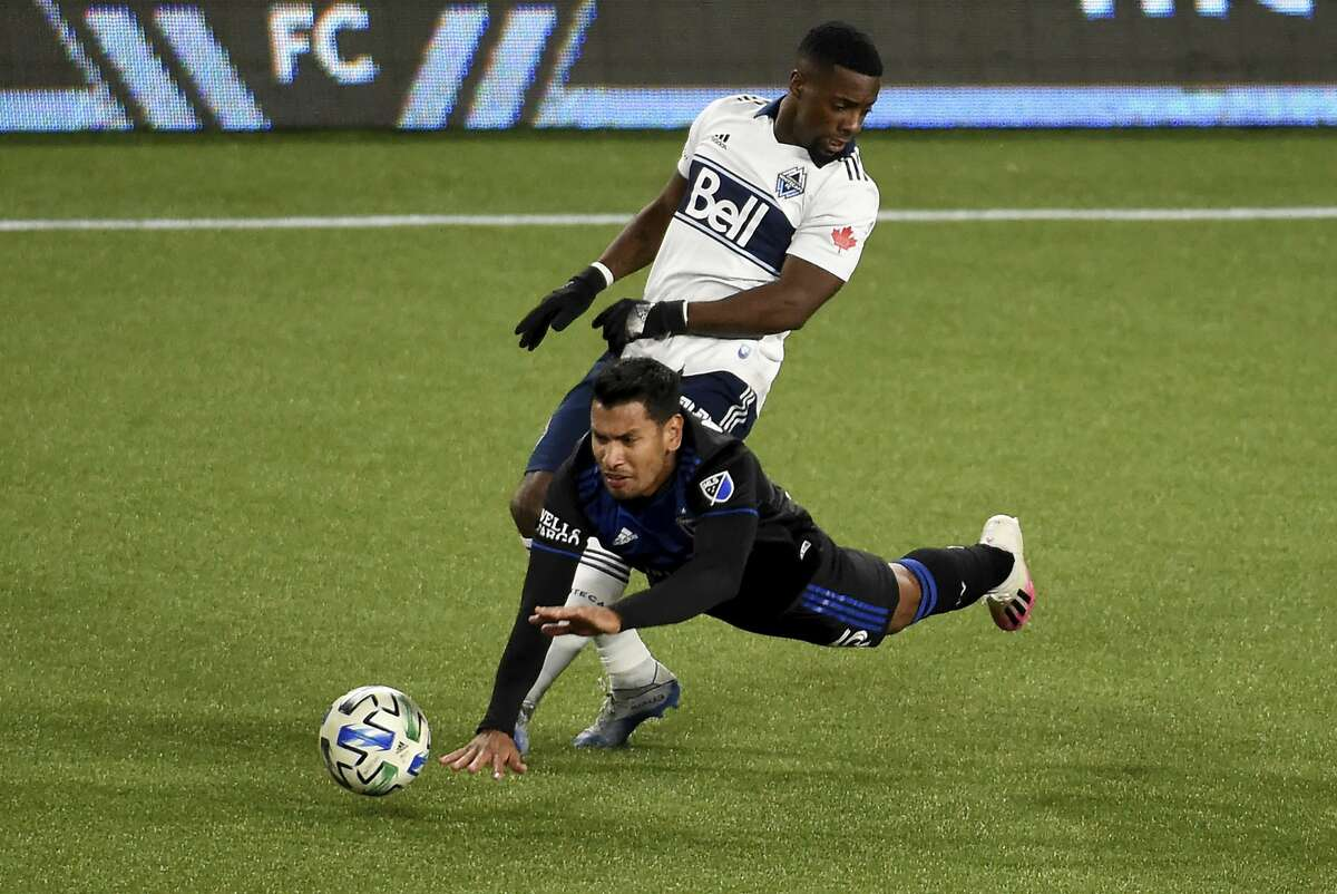 Earthquakes forward Andres Rios is tripped up by Whitecaps forward Cristian Dajome on Saturday. San Jose resumes its pursuit of a playoff spot at home against Real Salt Lake at 7:30 p.m. Wednesday (NBCSCA/1050).