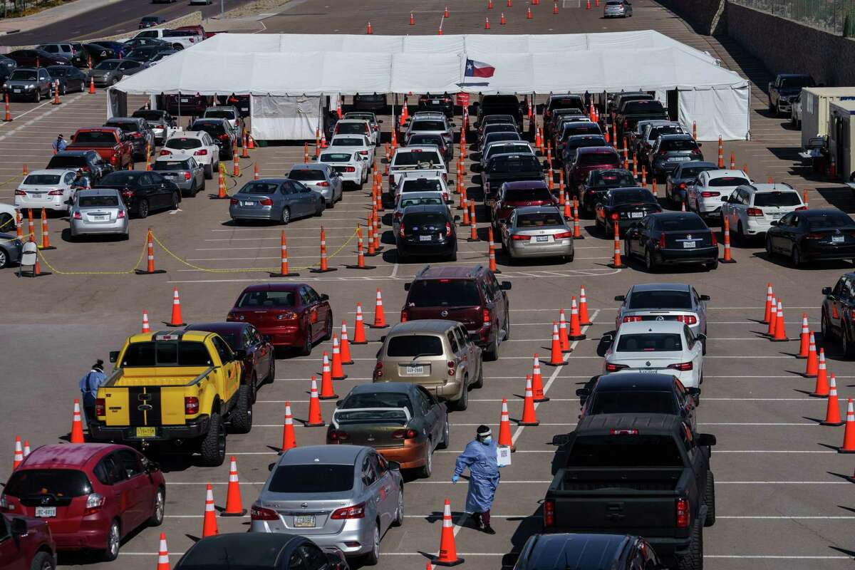 Cars line up for COVID-19 tests at the University of Texas El Paso on Oct. 23.