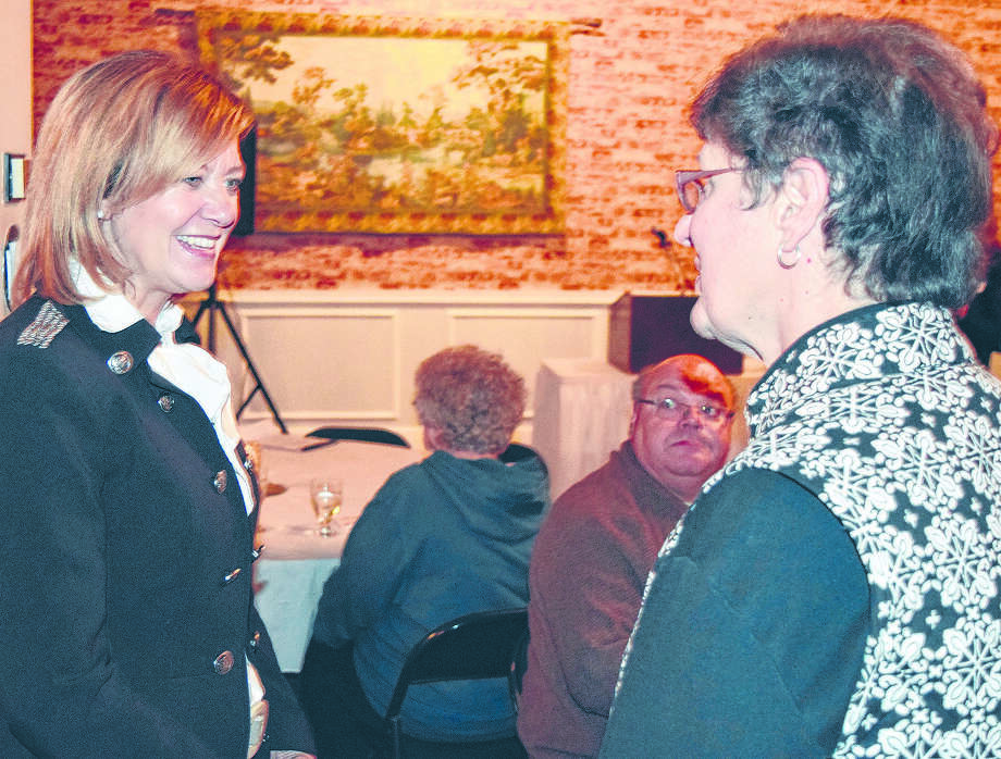 Barb Baker speaks with state Rep. Jeanne Ives (left) during a 2017 reception. Photo: Journal-Courier