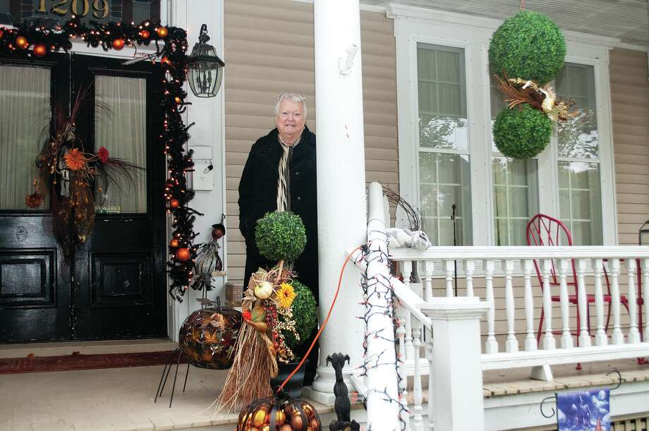 Joy French Becker has come up with a creative way to deliver Halloween candy at her house on West State Street by using PVC pipes to deliver candy to trick or treaters. Becker and family members plan on adding some additional lights and decorations with the goal of keeping a safe distance on Halloween night. Photo: Darren Iozia | Journal-Courier / Jacksonville Journal-Courier