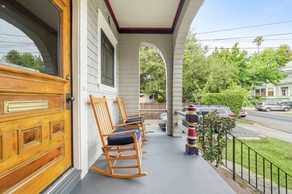 A front porch is perfect for people watching and rocking.