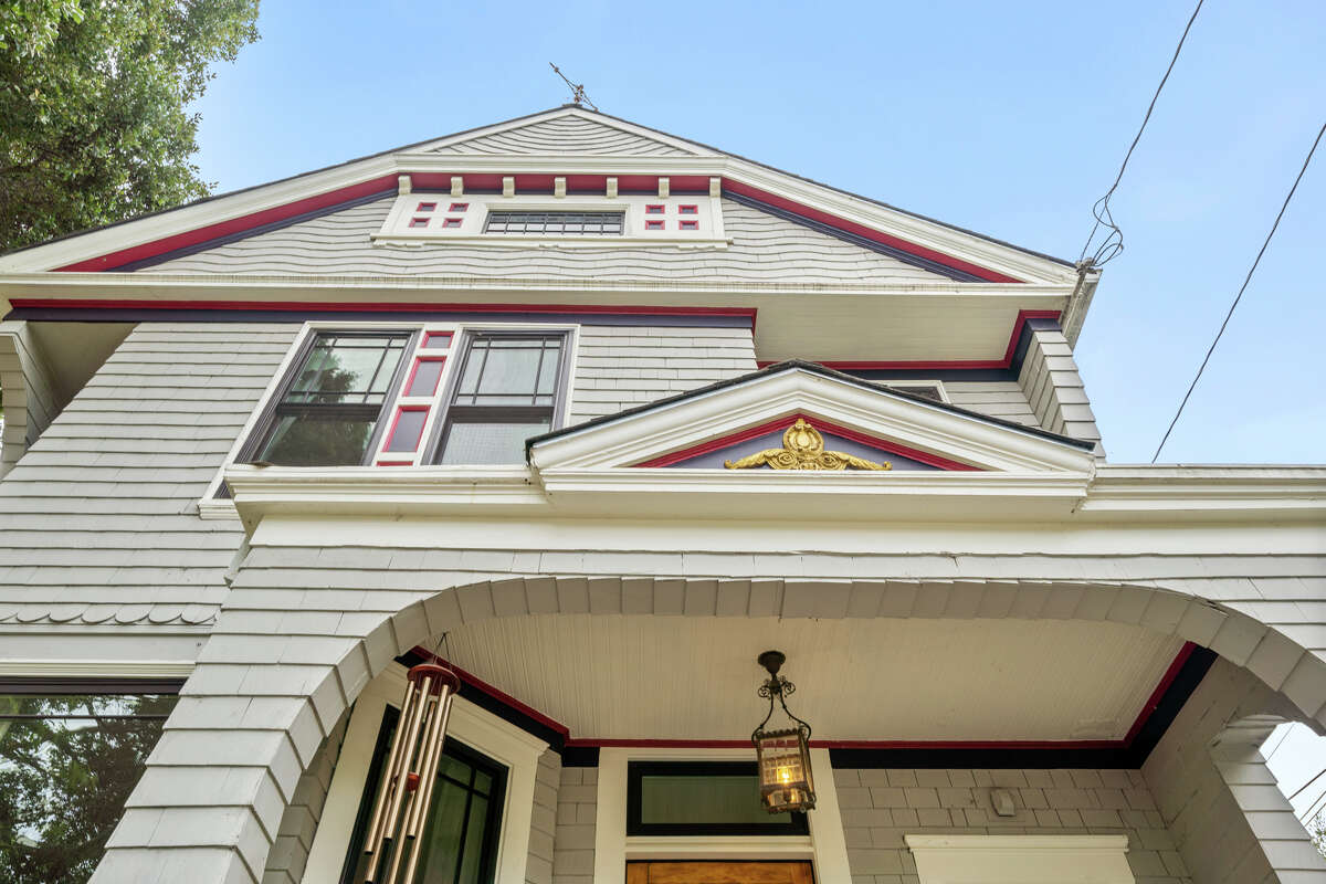 Queen Anne embellishments and flourishes are well preserved on the home's exterior.
