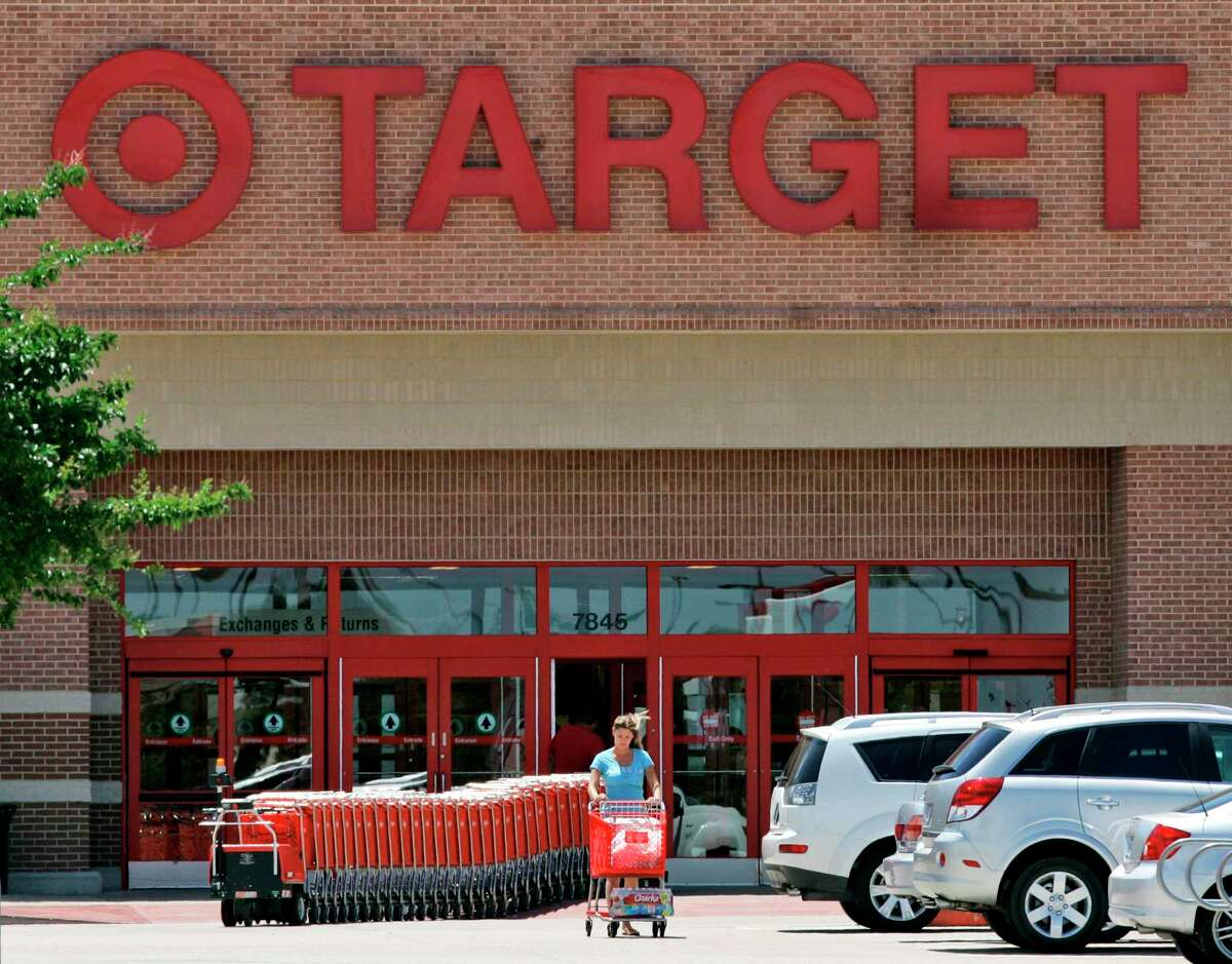 In this file photo, a shopper leaves a Target store in Irving. Retail sales slowed in Texas in October, according to the Federal Reserve Bank of Dallas.