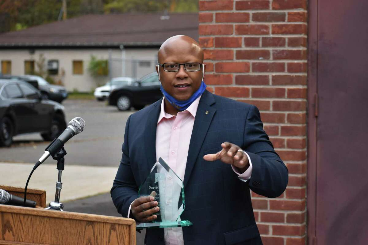 Project Longevity recognized city police, parole officers, and members of the New Haven community with awards Tuesday. Here, the Rev. Roger Johnson speaks.