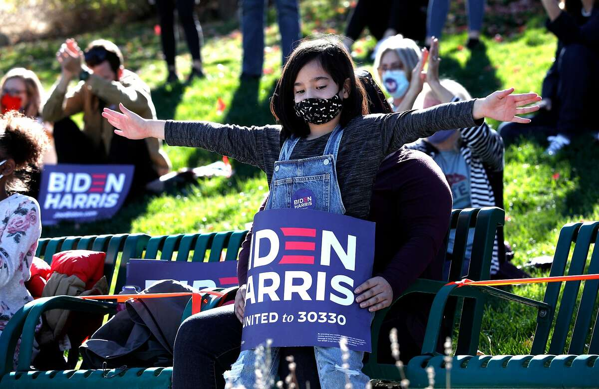 9-year-old MIranda Vega of Reno applauds Senator Kamala Harris Vice presidential candidate during a GOTV (get out the vote) mobilization rally at the Robert Z. Hawkins Amphitheater in Reno, Nevada, Ca., on Tues. Oct. 27, 2020,,