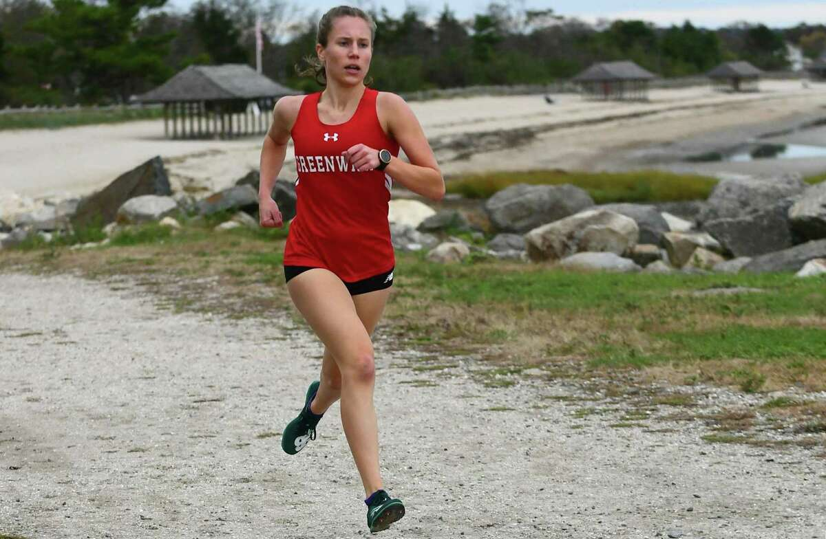 Mari Noble runs to a first-place finish in a meet against Darien on Tuesday at Tod's Point in Greenwich.