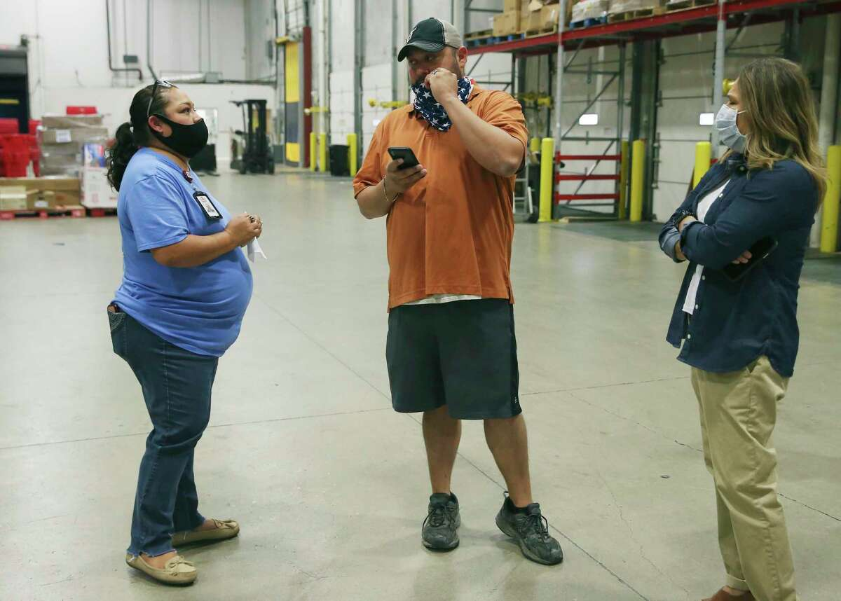 San Antonio Food Bank Produce Procurement Manager Dayna Robokowski, left, CRE8AD8 owner Gregorio Palomino, after he delivered the first boxes of food to the San Antonio Food Bank, Thursday, May 28, 2020.