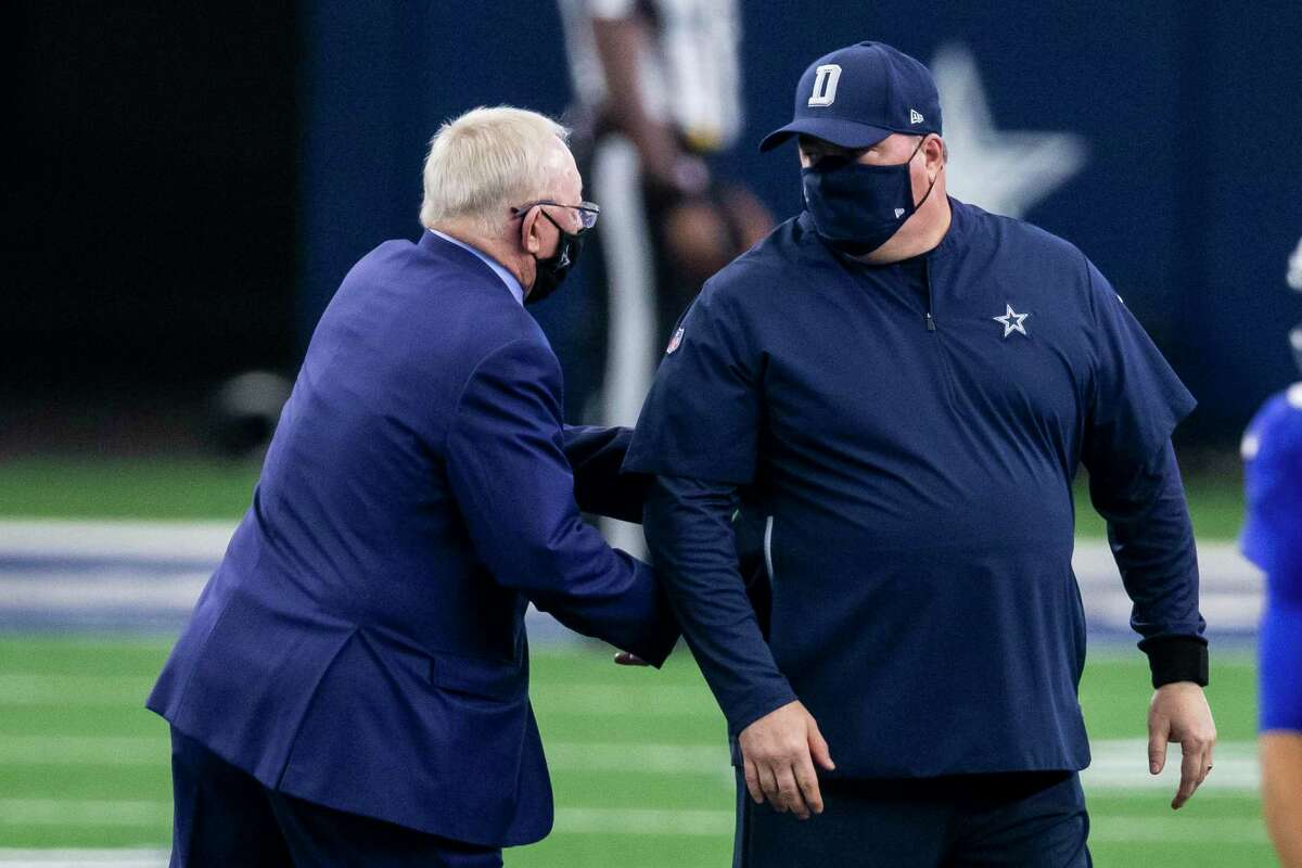 Dallas Cowboys owner Jerry Jones, left, greets head coach Mike McCarthy before an NFL football game against the New York Giants, Sunday, Oct. 11, 2020, in Arlington, Texas. Dallas won 37-34. (AP Photo/Brandon Wade)