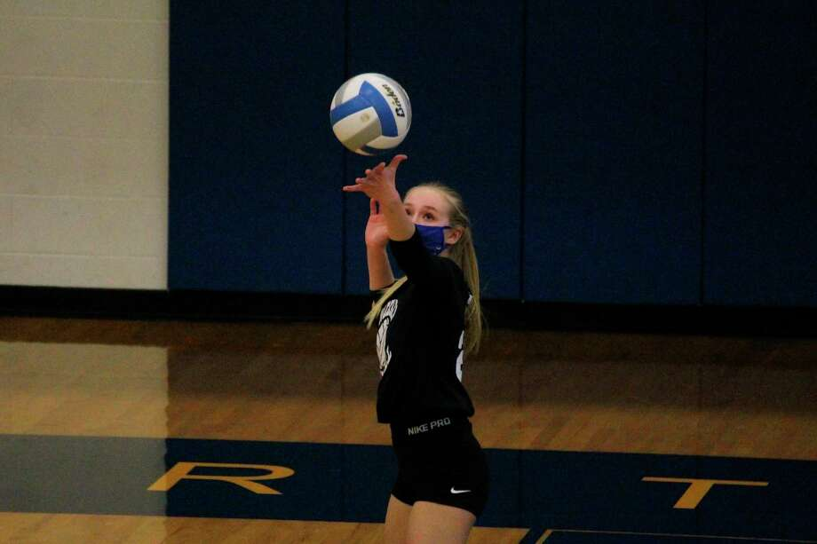 Madison Gutowski serves the ball against Mason County Eastern on Oct. 27. (Photo/Robert Myers)