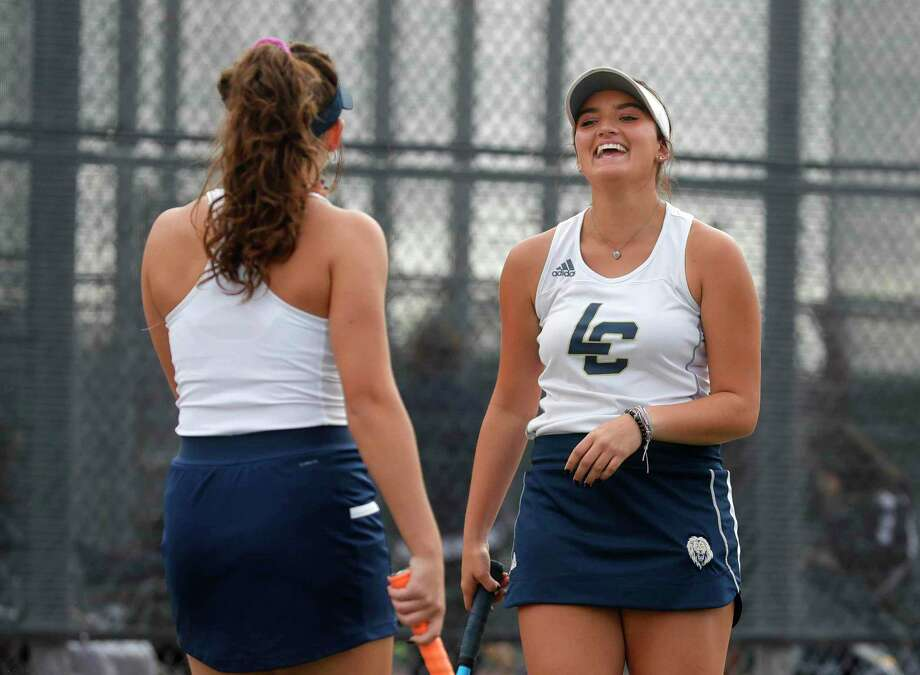 Lake Creek's Jordyn Englishbee share a laugh with double partner A'mri Silver during a high school bi-district team tennis match at Magnolia West High School, Tuesday, Oct. 27, 2020, in Conroe. Photo: Jason Fochtman, Houston Chronicle / Staff Photographer / 2020 © Houston Chronicle