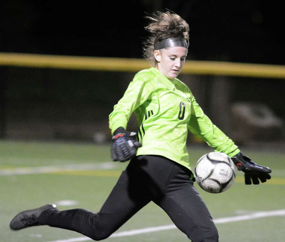 Hand goalie Brooke Salvati kicks the ball during Tuesday's game against Guilford. Photo: Dave Phillips / For Hearst Connecticut Media / Stamford Advocate Freelance