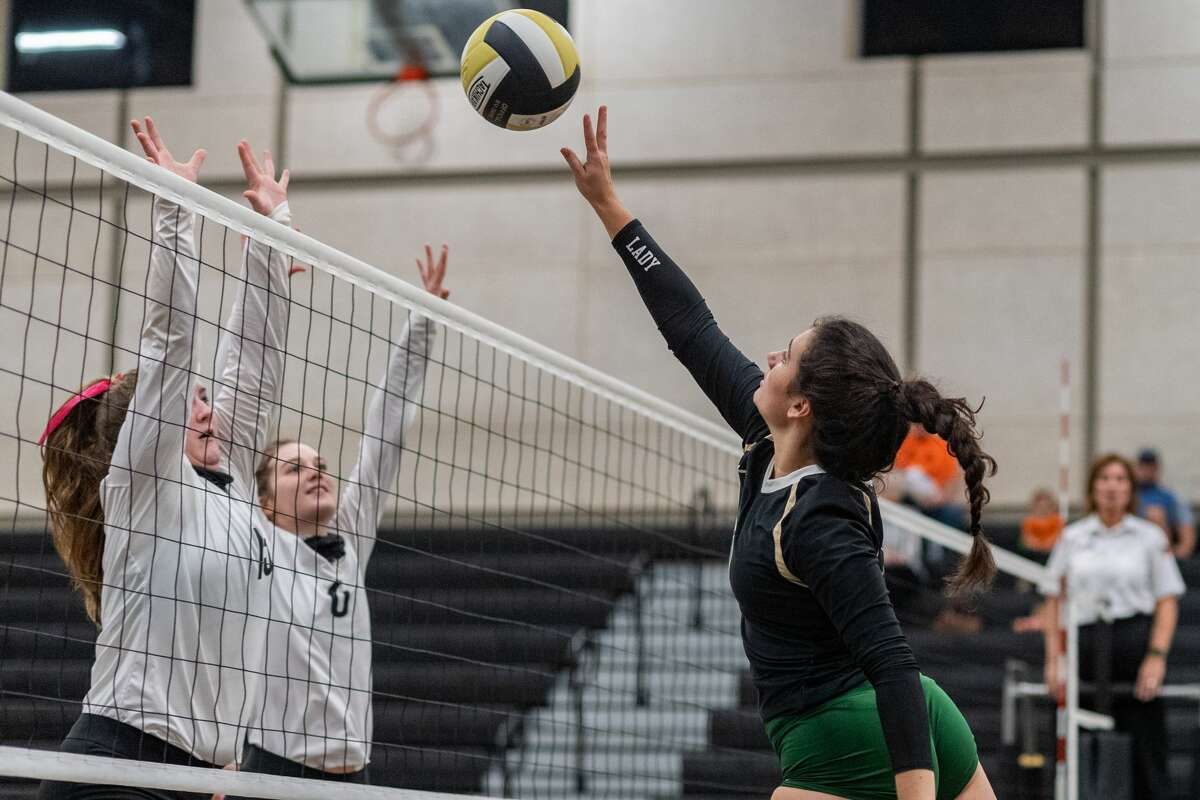 LC-M's Alyssa Ammons (13) finesses the ball over the net. The Lady Pirates of Vidor took on the Little Cypress-Mauriceville Lady Bears in a volleyball contest to determine who will be the No. 3 seed from 22-4A district. Photo made on October 27, 2020. Fran Ruchalski/The Enterprise