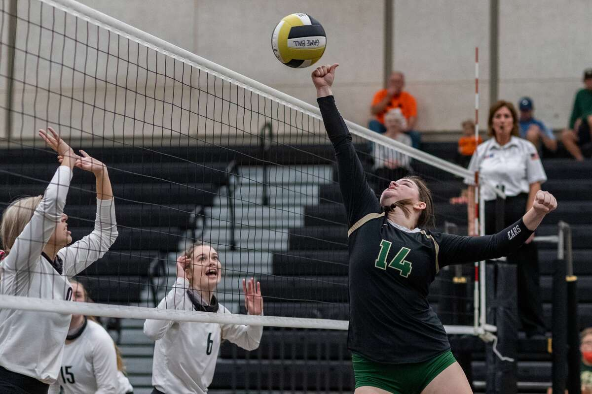 LC-M's Hallie Maddox (14) punches the ball over the net in the first set. The Lady Pirates of Vidor took on the Little Cypress-Mauriceville Lady Bears in a volleyball contest to determine who will be the No. 3 seed from 22-4A district. Photo made on October 27, 2020. Fran Ruchalski/The Enterprise