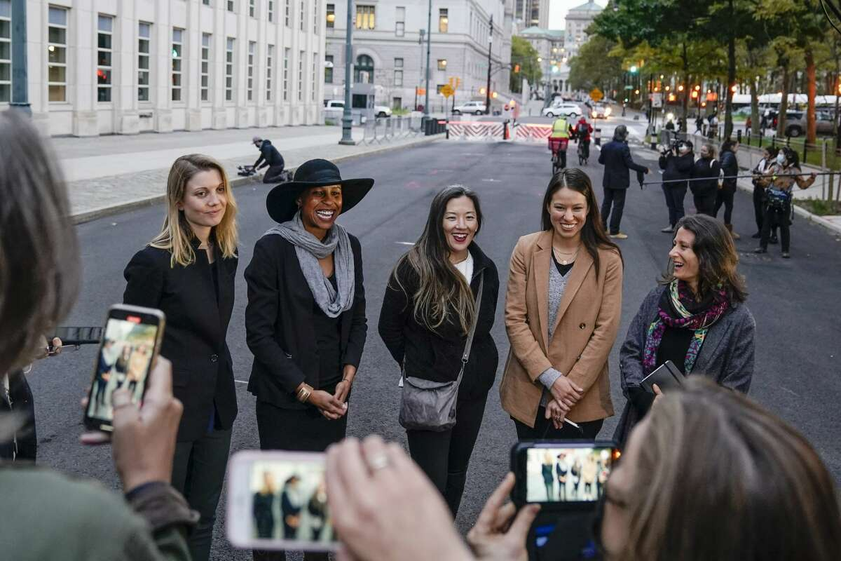 Nicki Clyne, left, Michelle Hatchette, second from left, Linda Chung, center, and Dr. Danielle Roberts, right, speak outside Brooklyn federal court following the sentencing hearing for self-improvement guru Keith Raniere Tuesday, Oct. 27, 2020, in New York. Raniere, the NXIVM leader, was sentenced to 120 years. (AP Photo/Frank Franklin II)