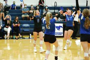 Friendswood players celebrate a point against La Porte Tuesday at Friendswood High School.