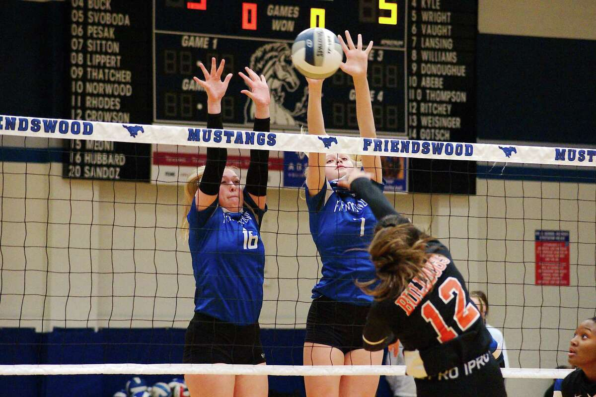 La Porte's Jenessa Morales-Garcia (12) tries to hit a shot past Friendswood's Megan Hubbard (16) and Sarah Sitton (7) Tuesday at Friendswood High School.