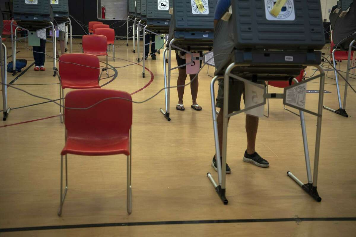 Voters cast ballots at an early voting polling location for the 2020 Presidential elections in Houston, Texas, U.S., on Tuesday, Oct. 13, 2020. Photographer: Callaghan O'Hare/Bloomberg