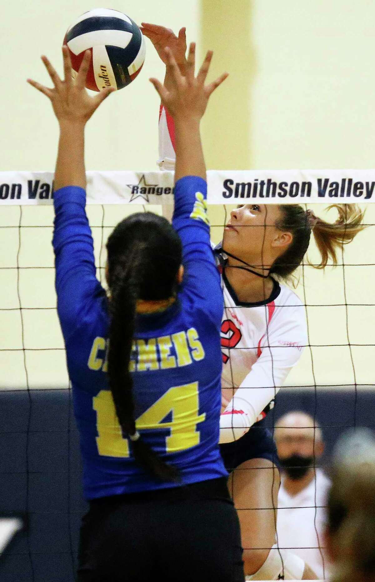 Ranger hitter Bekah Williams slams a shot over Crislyne Moreno as Smithson Valley hosts Clemens in volleyball on Oct. 27, 2020.