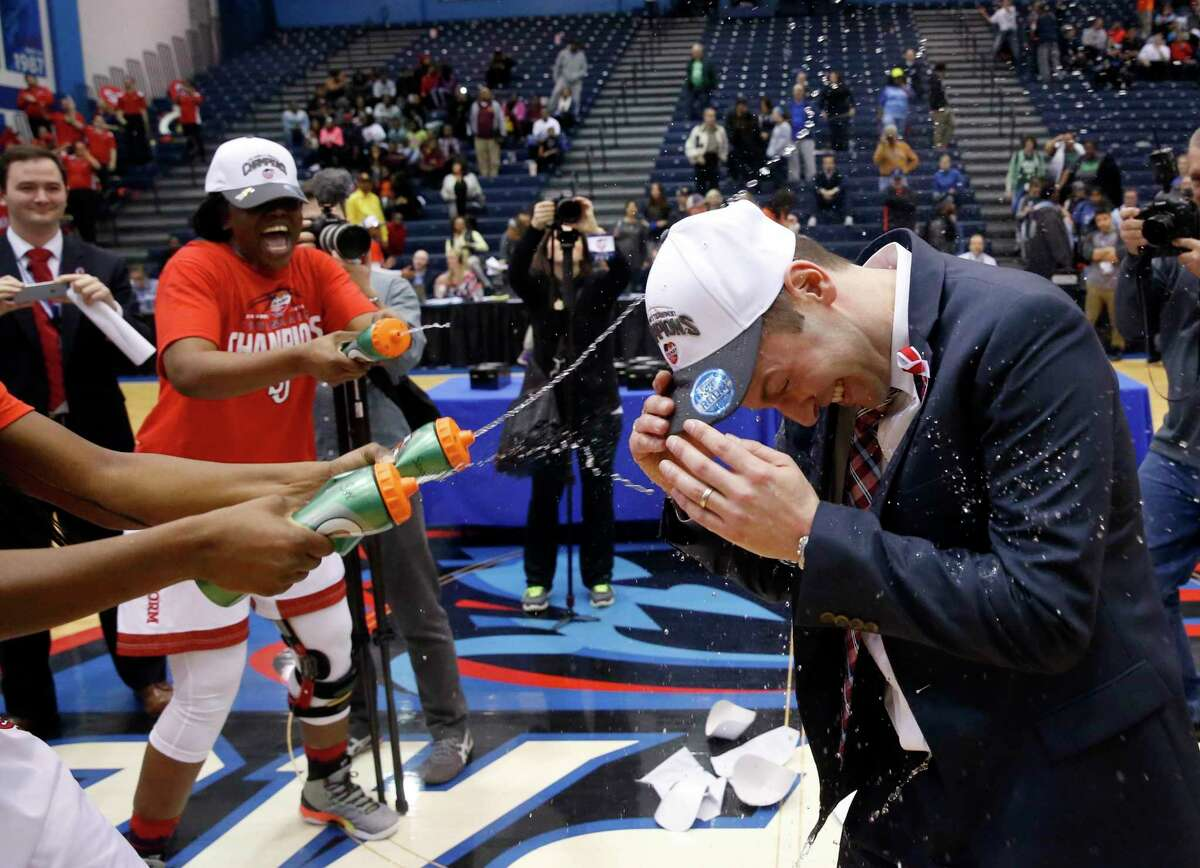 St. John's coach Joe Tartamella, right, is squirted with water by his players after his team won the Big East Tournament championship game over Creighton in 2016.