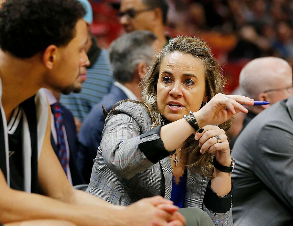 MIAMI, FLORIDA - JANUARY 15: Assistant coach Becky Hammon of the San Antonio Spurs talks with Bryn Forbes #11 against the Miami Heat during the first half at American Airlines Arena on January 15, 2020 in Miami, Florida. NOTE TO USER: User expressly ackn