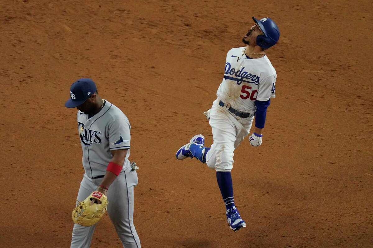 Los Angeles Dodgers' Mookie Betts celebrates after a home run against the Tampa Bay Rays during the eighth inning in Game 6 of the baseball World Series.