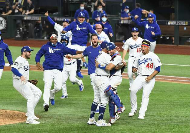 The Los Angeles Dodgers celebrate a 3-1 series-clinching win against the Tampa Bay Rays in Game 6 of the World Series at Globe Life Field in Arlington, Texas, on Tuesday, Oct. 27, 2020. (Wally Skalij/Los Angeles Times/TNS) Photo: Wally Skalij, TNS