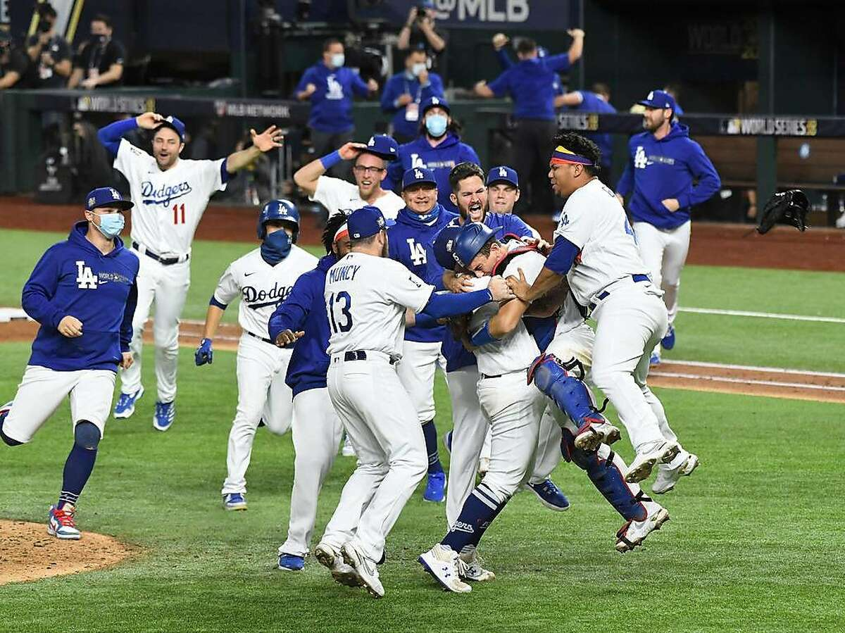 The Los Angeles Dodgers celebrate a 3-1 series-clinching win against the Tampa Bay Rays in Game 6 of the World Series at Globe Life Field in Arlington, Texas, on Tuesday, Oct. 27, 2020. (Wally Skalij/Los Angeles Times/TNS)