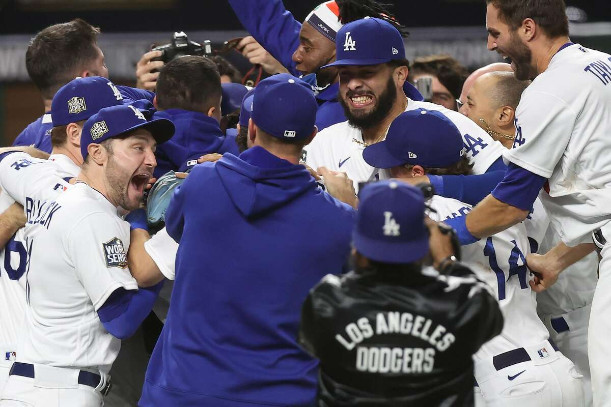 ARLINGTON, TEXAS - OCTOBER 27: The Los Angeles Dodgers celebrate defeating the Tampa Bay Rays 3-1 in Game Six to win the 2020 World Series at Globe Life Field on October 27, 2020 in Arlington, Texas. (Photo by Tom Pennington/Getty Images)