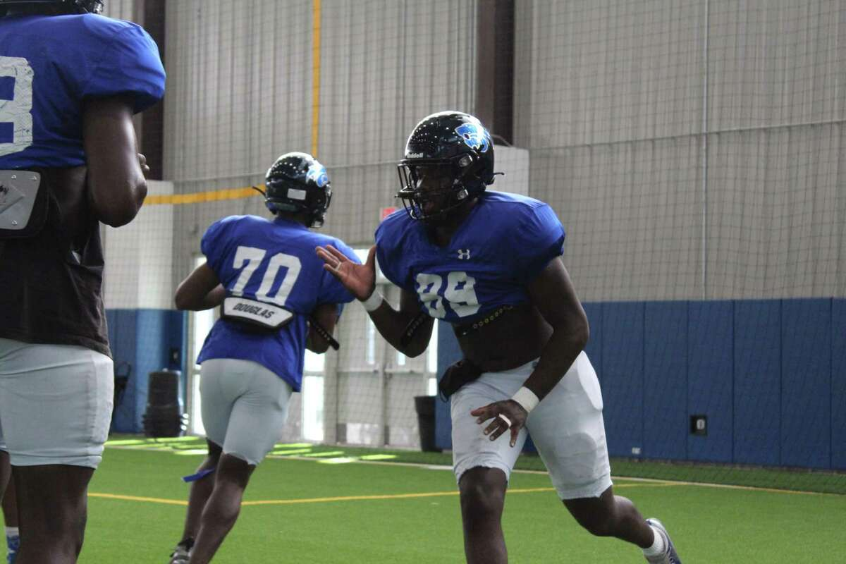 C.E. King defensive end William Jones working during a drill in practice.