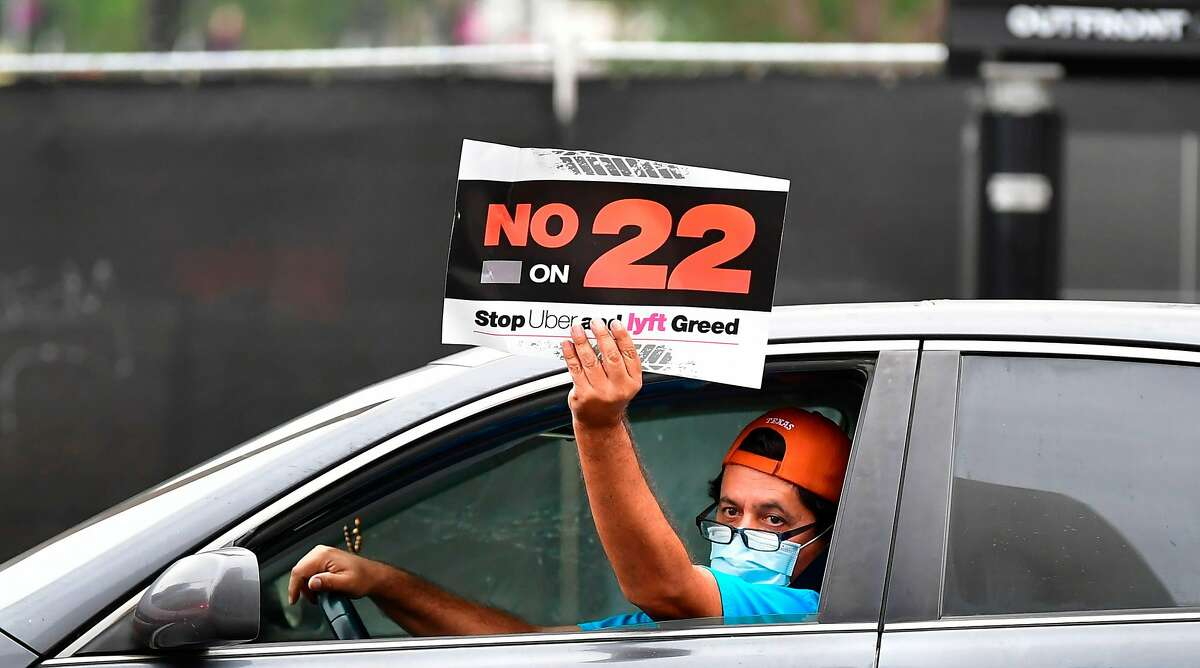 App-based drivers from Uber and Lyft protest in a caravan in front of City Hall in Los Angeles on Oct. 22, 2020, where elected leaders hold a conference urging voters to reject Proposition 22, which would classify app-based drivers as independent contractors and not employees or agents.