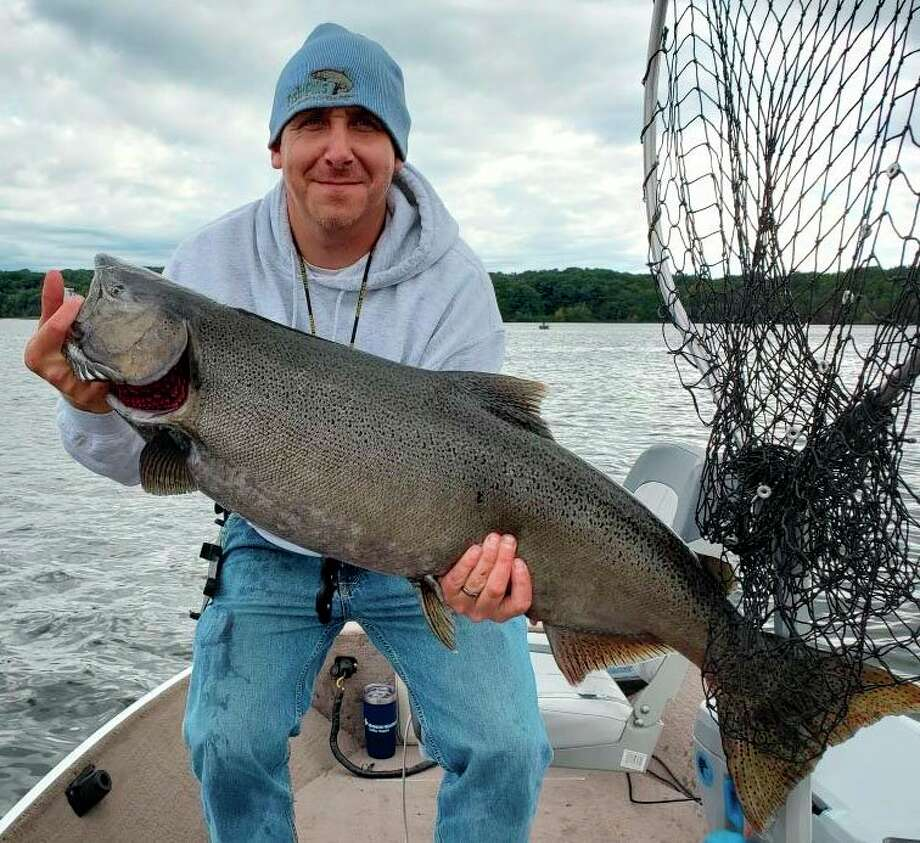 Evart's Paul Higgins continues to bring home trophy fish. (Herald Review file photo)