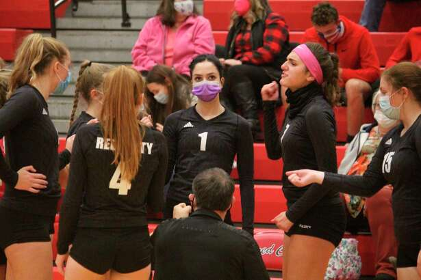 Reed City volleyball players receive instructions from coach Don Patterson in last week's match with Fremont. (Herald Review photo/John Raffel)