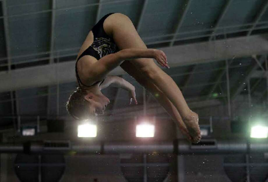 Kathryn Connolly, 17, practices last week at the Davis Natatorium in preparation for the 1-meter springboard starting Thursday at the Junior World Championships in Tucson, Ariz.