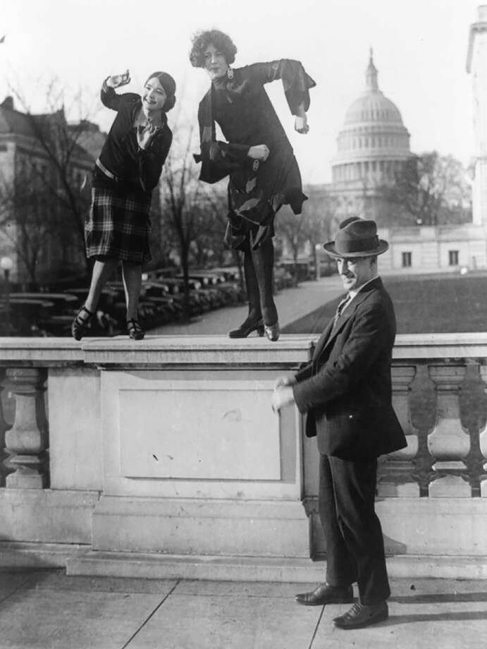 Democratic Rep. T.S. McMillan, Charleston, S.C., with flappers Ruth Bennett and Sylvia Clavins, who are doing the Charleston, with the U.S. Capitol in background. Photo: Library Of Congress. / Library of Congress
