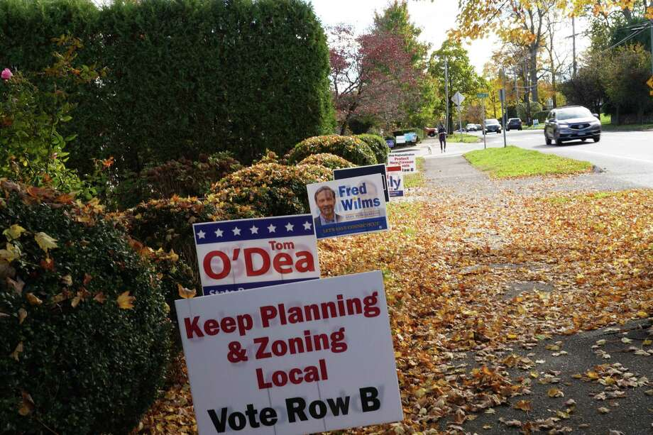 A plea to keep control of zoning in local hands is part of a group of Republican campaign signs on the corner of Church Street and South Avenue in New Canaan Tuesday, Oct. 28, 2020. Efforts Republicans fear will regionalize zoning were discussed at a Zoom meeting that night. Photo: Grace Duffield Hearst Connecticut Media /