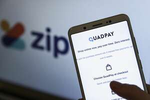 In this illustration photo taken in Ankara, Turkey logo of Zip Co Ltd is displayed on a laptop's screen and QuadPay is displayed on a smartphone's screen on June 10, 2020. (Photo by Esra Hacioglu/Anadolu Agency via Getty Images)
