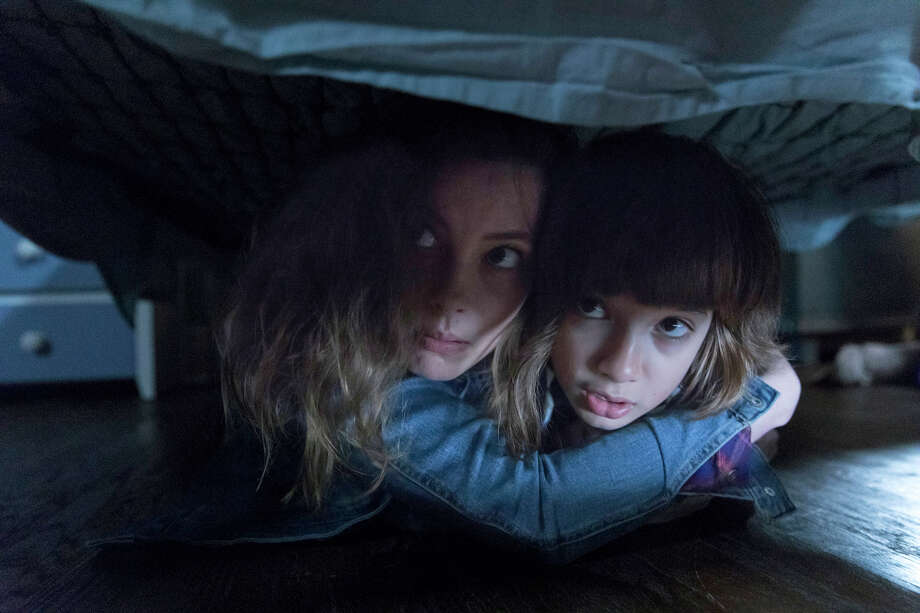 """Gillian Jacobs, left, and Azhy Robertson in """"Come Play."""" Photo: Jasper Savage/Amblin Partners/Focus Features / Focus Features"""