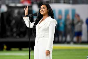 Demi Lovato performs the National Anthem onstage during Super Bowl LIV at Hard Rock Stadium on February 02, 2020 in Miami Gardens, Florida. The Texas native is slated to host the 2020 E! People's Choice Awards this year. (Photo by Jeff Kravitz/FilmMagic)