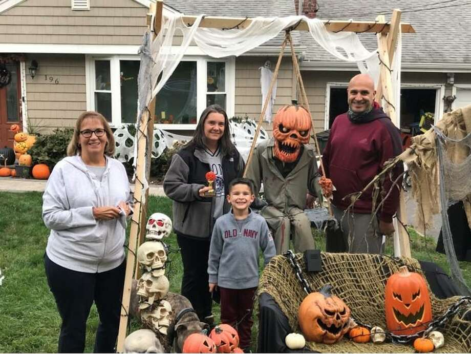 Three Trumbull families recently received gift cards and trophies as part of the Trumbull Community Women Halloween House Decorating Contest. The contest had 26 entries. Scariest: 196 Sterling Road, Rich and Kim Roldan; Most Whimsical: 21 Lantern Hill, Tiffany Eastman and Todd Gagner; and Best Homemade Decorations, 10 Fox Court, Sandy Shilling. Contest chairman Loretta Chory delivered the prizes. Photo: Contributed Photos /