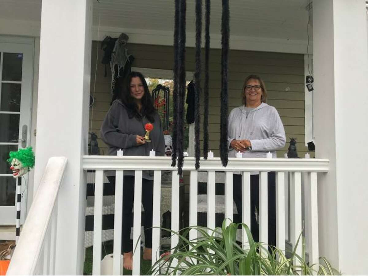 A Halloween House Decorating contest, sponsored by Trumbull Community Women (TCW) was held this month and 26 houses were entered in the contest. Each winner received a gift certificate and a trophy. The winners are shown receiving their awards from Halloween House Decorating Chairwoman Loretta Chory. For Scariest: 196 Sterling Road, Rich and Kim Roldan; Most Whimsical: 21 Lantern Hill, Tiffany Eastman and Todd Gagner; and Best Homemade Decorations, 10 Fox Court, Sandy Shilling.