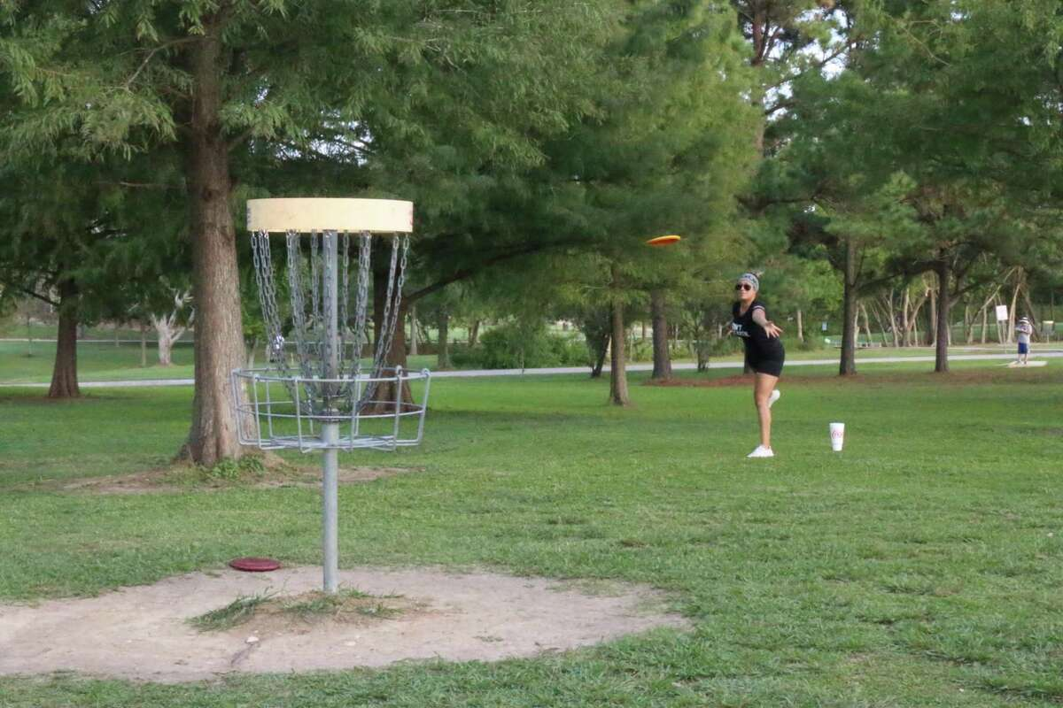 Vanessa Melendez has her eyes on the chains at Taylor Lake Village Disc Golf Course.