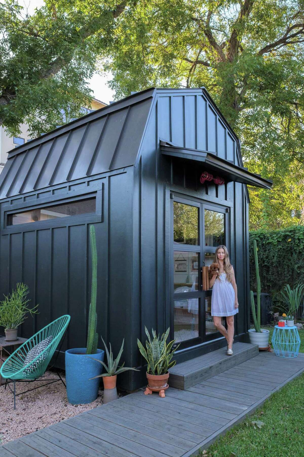"""Houston Ballet first soloist Allison Miller fitted out her """"she shed"""" studio for sewing and crafts. Her new pup Penny is often there with her."""