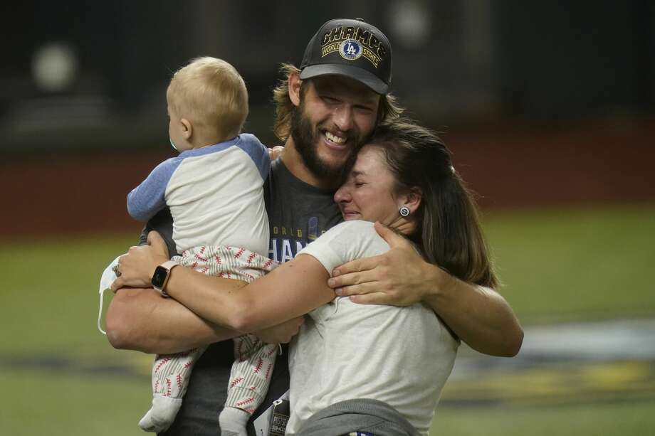 Los Angeles Dodgers' pitcher Clayton Kershaw celebrates with family after the Dodgers defeated the Tampa Bay Rays 3-1 to win the World Series on Tuesday, Oct. 27, 2020, in Arlington, Texas. Photo: Eric Gay/AP / Copyright 2020 The Associated Press. All rights reserved