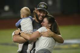 Los Angeles Dodgers' pitcher Clayton Kershaw celebrates with family after the Dodgers defeated the Tampa Bay Rays 3-1 to win the World Series on Tuesday, Oct. 27, 2020, in Arlington, Texas.