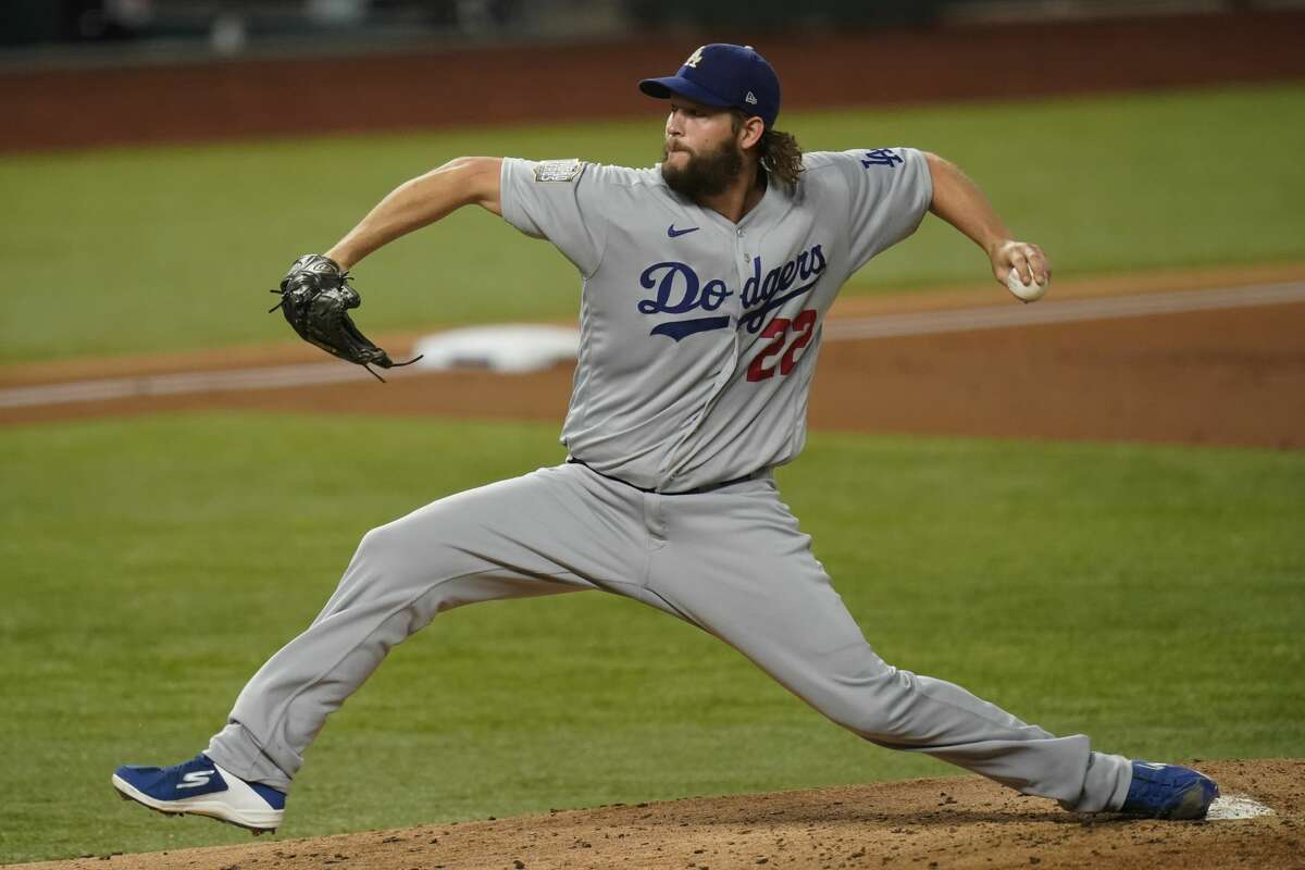 Los Angeles Dodgers' Clayton Kershaw pitches against the Tampa Bay Rays during the first inning of Game 5 of the World Series on Sunday, Oct. 25, 2020, in Arlington, Texas.