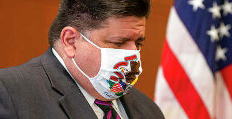 Illinois Gov. JB Pritzker lowers his head as Illinois Department of Public Health Director Dr. Ngozi Ezike announces seven additional deaths due to COVID-19 during a September press conference in Springfield. Photo: AP Photo