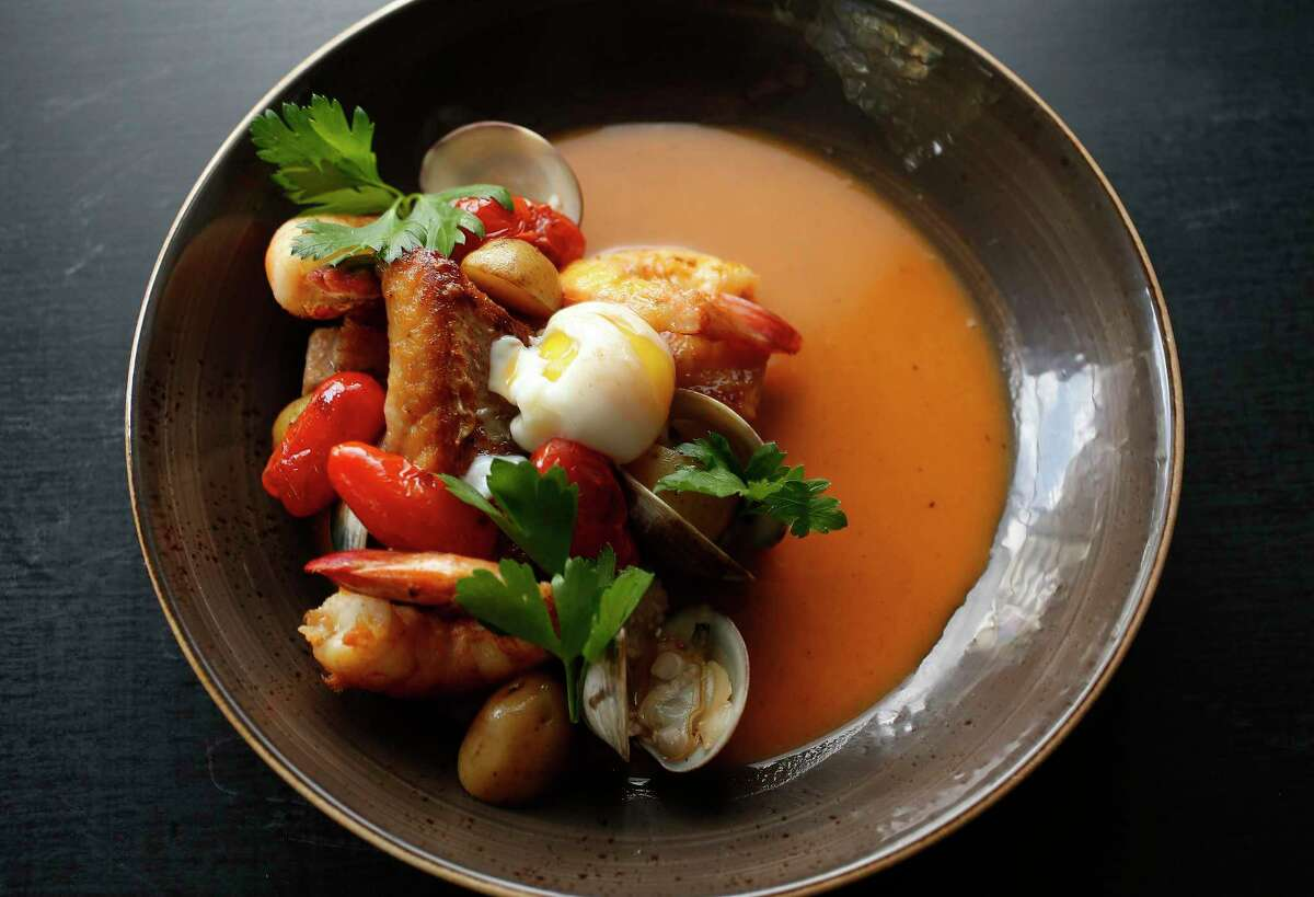 Holley's Muddled Stew combines braised pork belly, clams, shrimp, and redfish with a jammy egg in the chef's Gulf Coast take on bouillabaisse.
